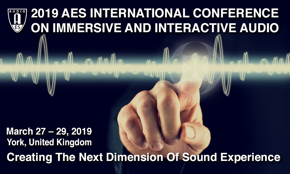 A finger points at a waveform on a dark background. Text above the finger reads '2019 AES International Conference on Immerisve and Interactive Audio'. Text below the finger reads 'March 27-29, 2019, York, United Kingdom. Creating the Next Dimension of Sound Experience'