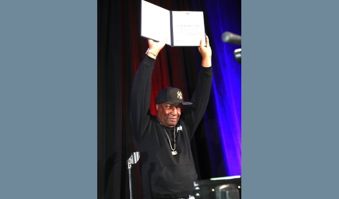 AES New York 2019 Convention keynote speaker Grandmaster Flash shows off his AES Honorary Member award, given for pioneering revolutionary and influential implementations of audio and music technologies for performance.